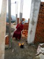 Khenpo Namgyal doing prayers at tje construction place